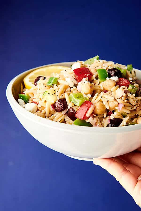 Greek orzo salad blue background