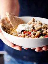 Healthy Greek Chicken Bowls holding