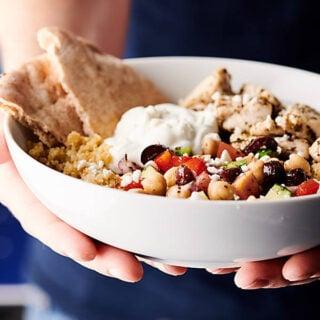 Healthy Greek Chicken Bowls holding