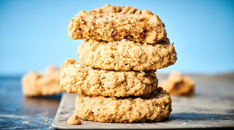 Four peanut butter oatmeal cookies stacked