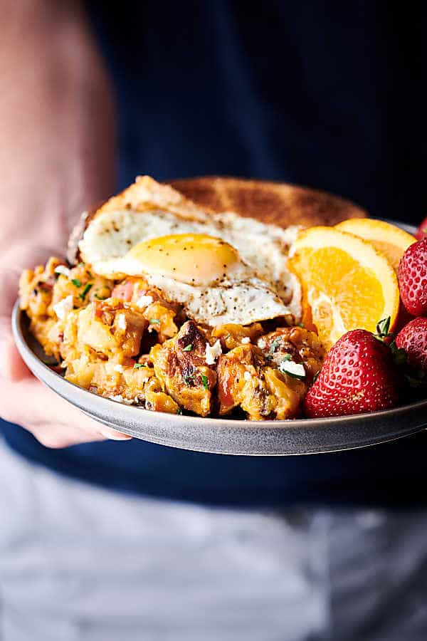 Cheesy Pork and Potato Breakfast Skillet holding in hands