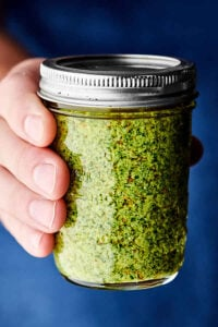 How to Make Easy Homemade Basil Pesto dark blue background