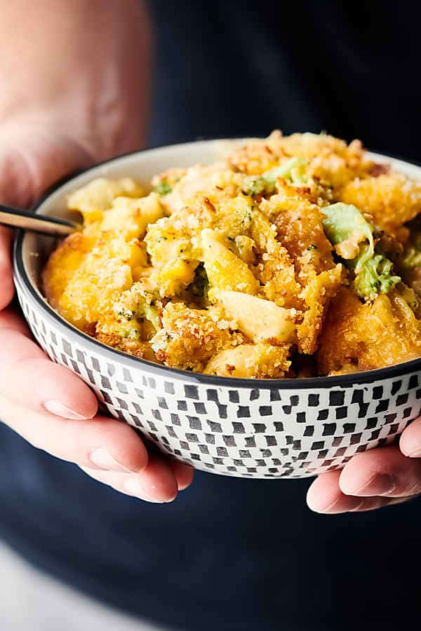 One Pot Chicken Broccoli Mac and Cheese holding in hands