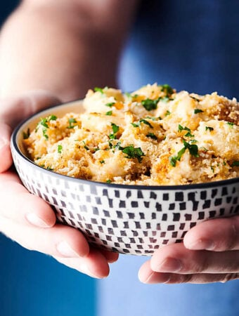 Crab Mac and Cheese holding in hands