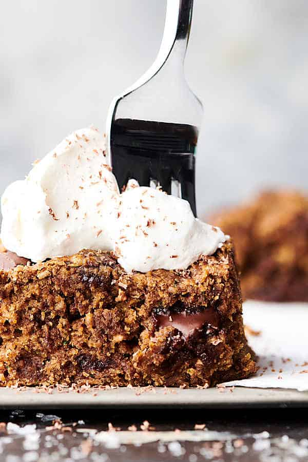 healthy zucchini oat bars topped with whipped cream