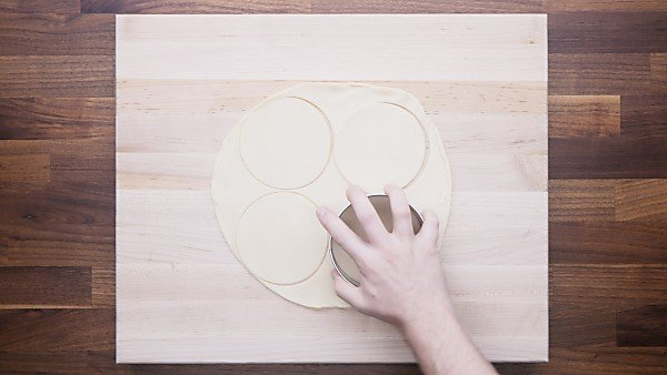 pie crust being cut with cookie cutter