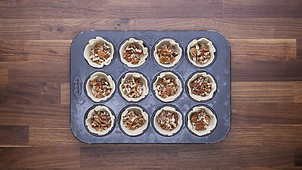 chopped pecan in pie crust cups