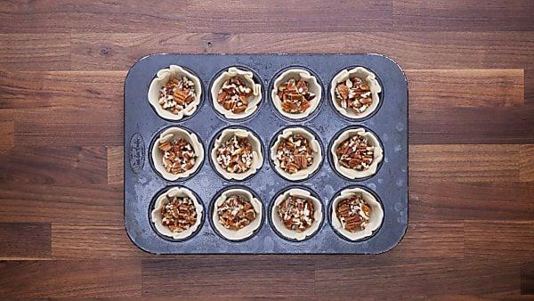 chopped pecan in pie crust cups
