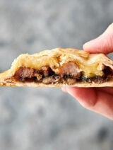 Pork, Brie, and Fig Hand Pies holding in hand