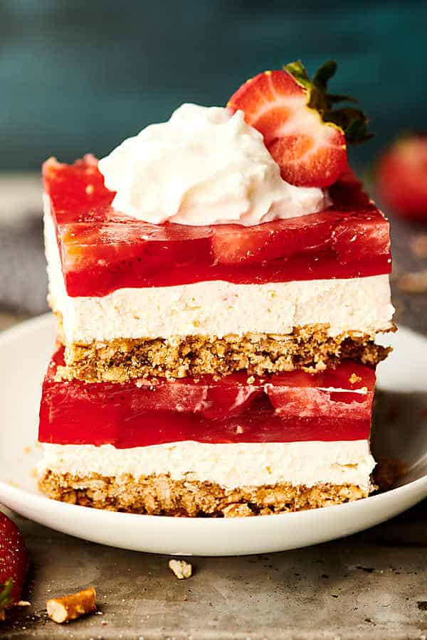 strawberry pretzel salad stacked with whipped cream