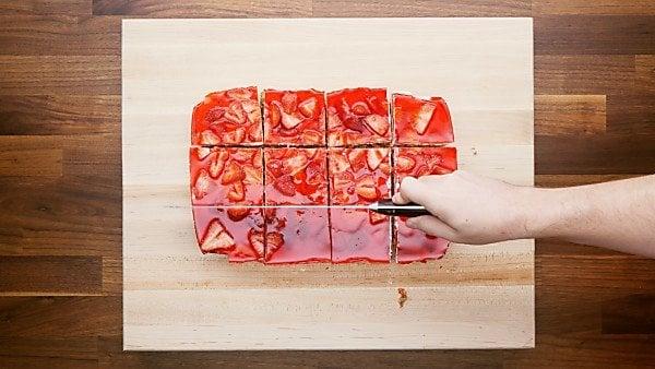 strawberry pretzel salad being cut