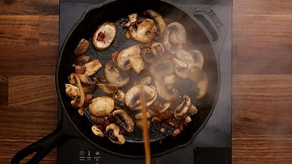 Mushrooms and bacon being cooked
