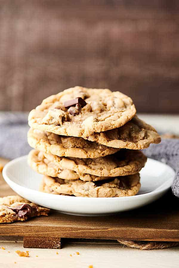 chewy chocolate chip cookies stacked on a plate