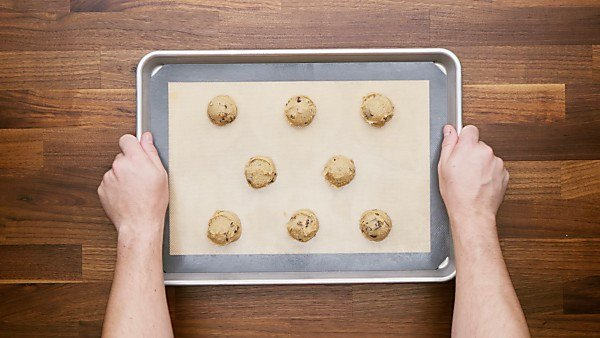 Cookie dough scooped onto baking sheet