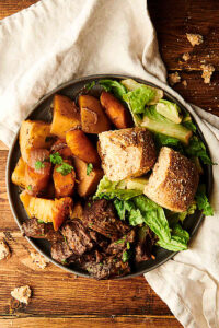 crockpot pot roast on a plate above
