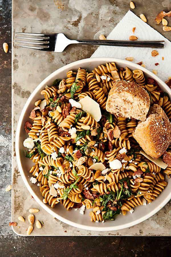 healthy sun dried tomato and arugula pasta above