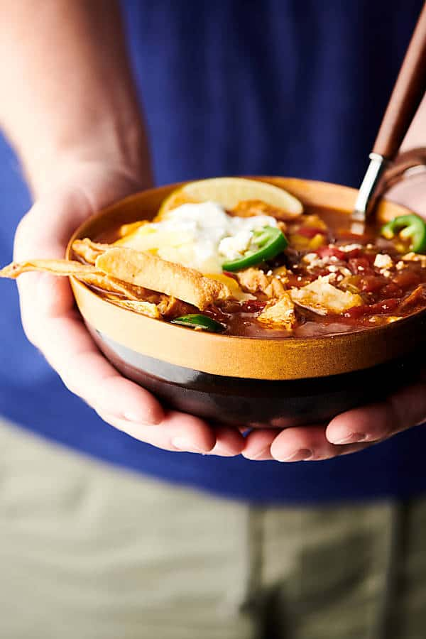 Instant Pot Chicken Tortilla Soup holding in hands