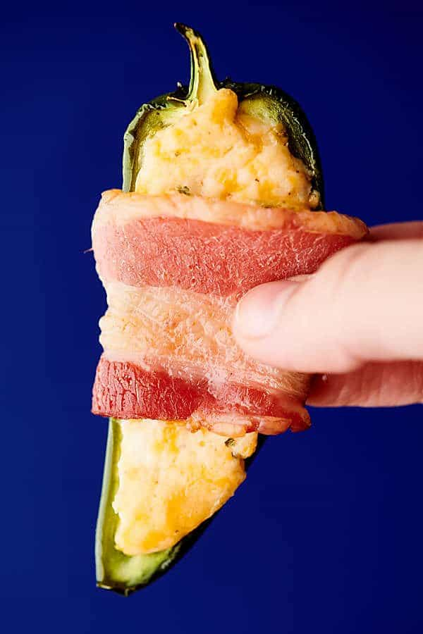 holding jalapeno poppers