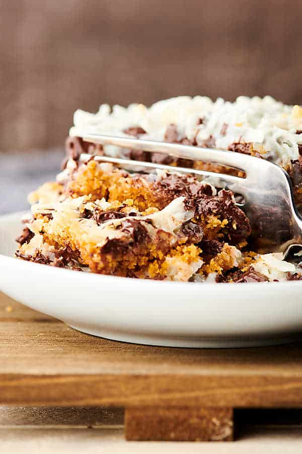 Magic Cookie Bars on plate with a fork