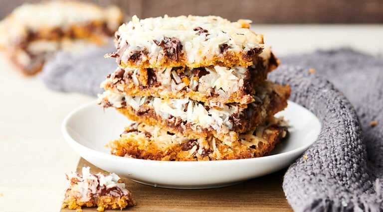 Magic Cookie Bars stacked on plate horizontal