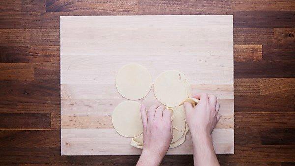 Pie crust dough being cut into circles