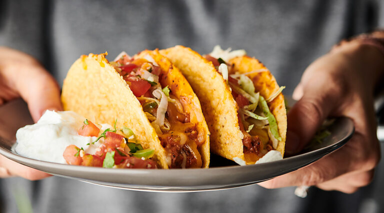 Supreme Pizza Tacos on a plate horizontal