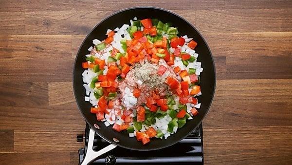 Veggies and sausage in skillet pan