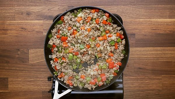 Cooked veggies and sausage in skillet