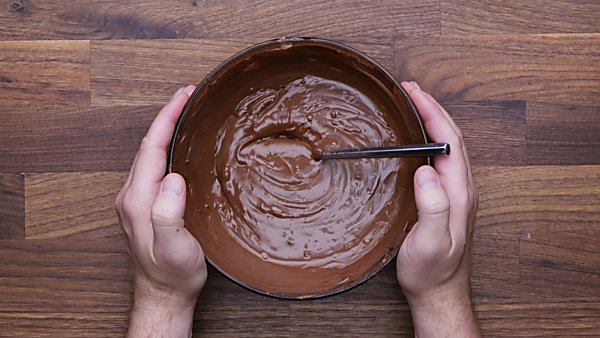 Chocolate topping for scotcheroos in bowl