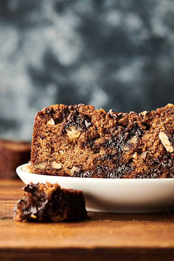 Slice of banana bread on plate from the side