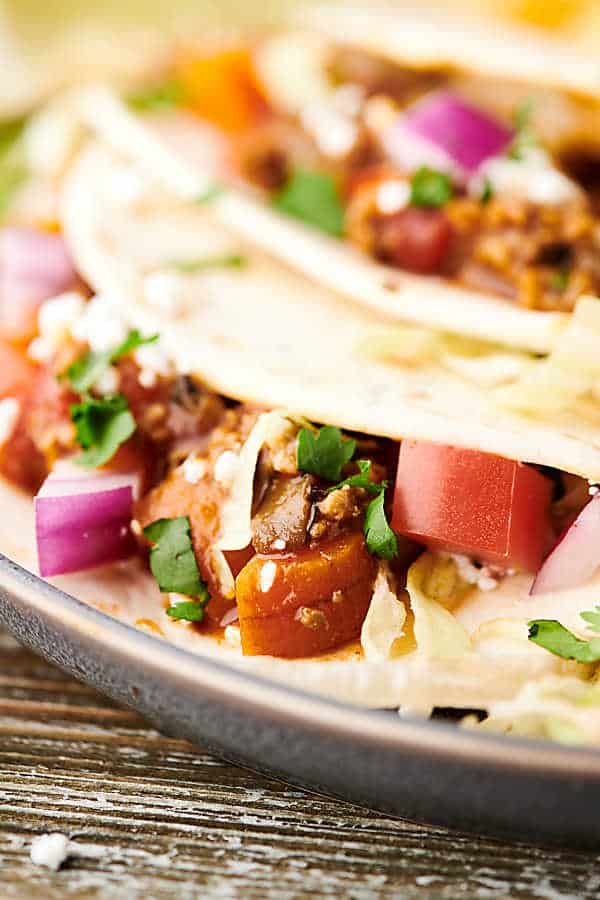 Closeup of instant pot turkey taco on plate with another taco in the background blurred