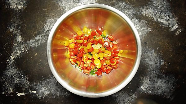 Chopped veggies for texas caviar in large mixing bowl