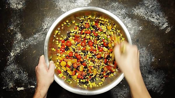 Texas caviar ingredients being mixed together