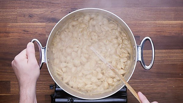 mac and cheese being stirred