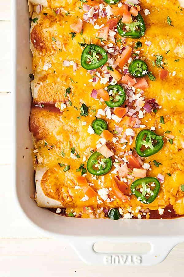 Dish of chicken enchiladas above