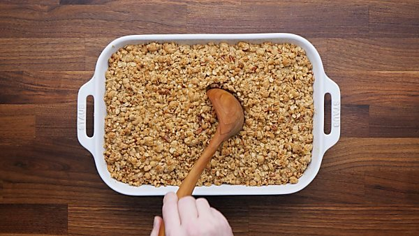 Finished french toast casserole with ladle being scooped out