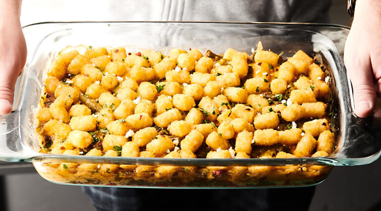 Dish of tater tot casserole held
