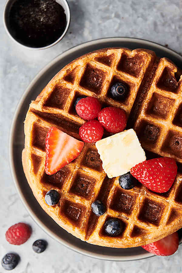 Waffle with butter and mixed berries above