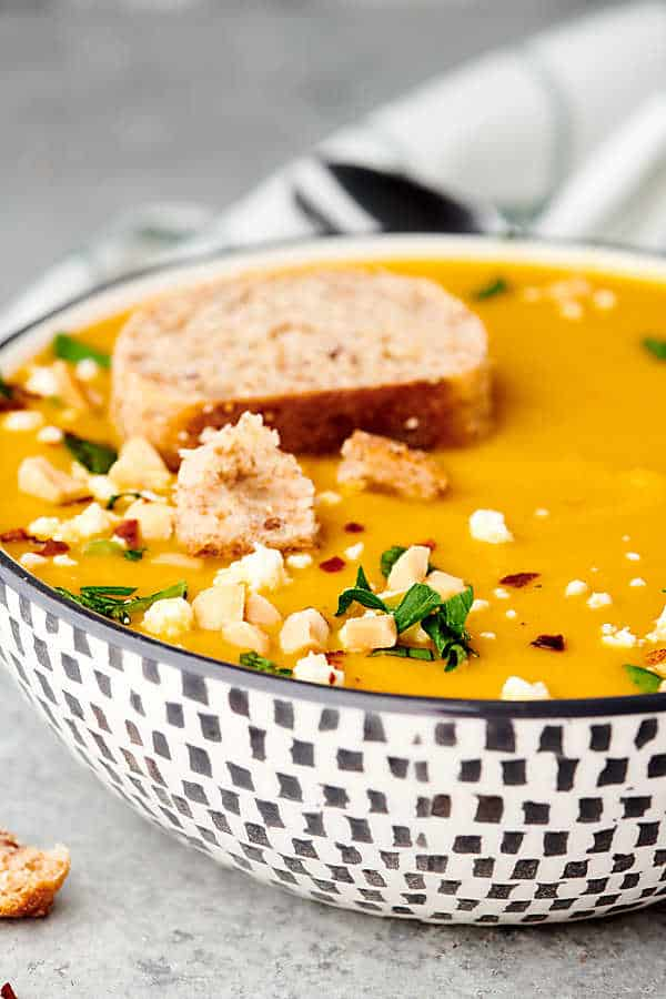 bowl of butternut squash soup with slice of bread on top
