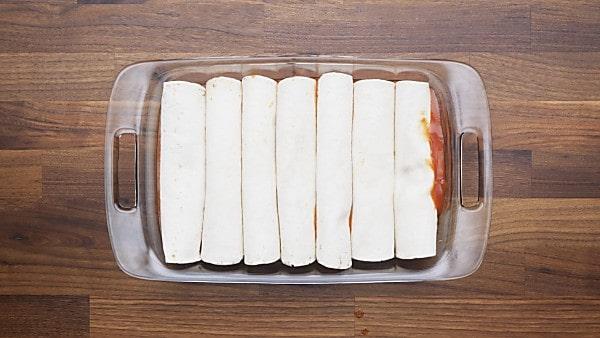 rolled enchiladas in baking dish