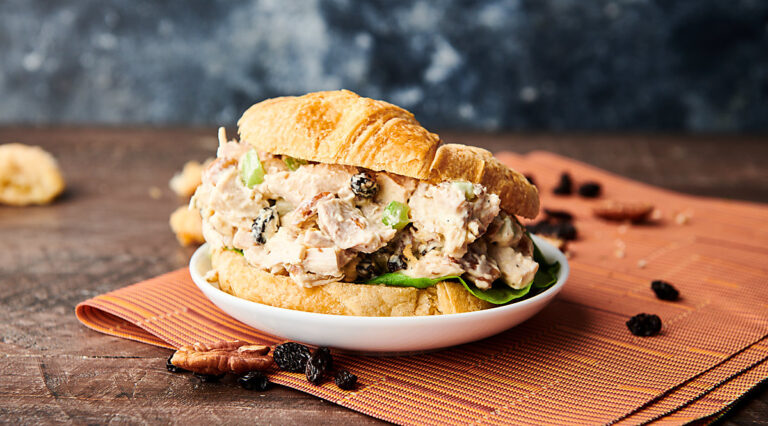 Chicken salad on a croissant on a plate