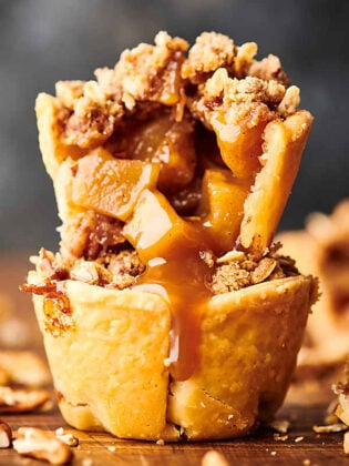 two mini apple pies stacked