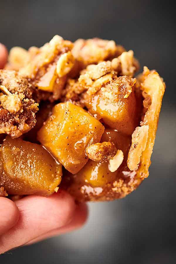 mini apple pie held