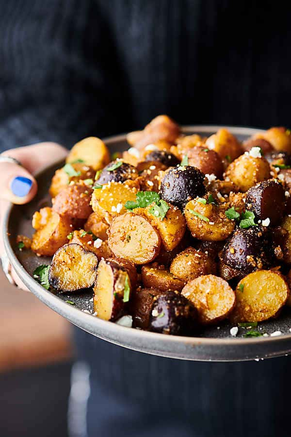 plate of roasted potatoes held