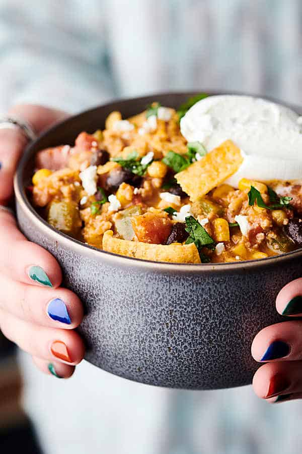 Bowl of taco soup held