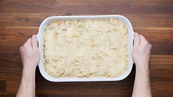 unbaked tuna casserole covered in panko and parmesan