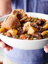 bowl of beef stew held