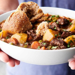 bowl of beef stew held