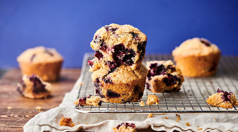 two blueberry muffins stacked
