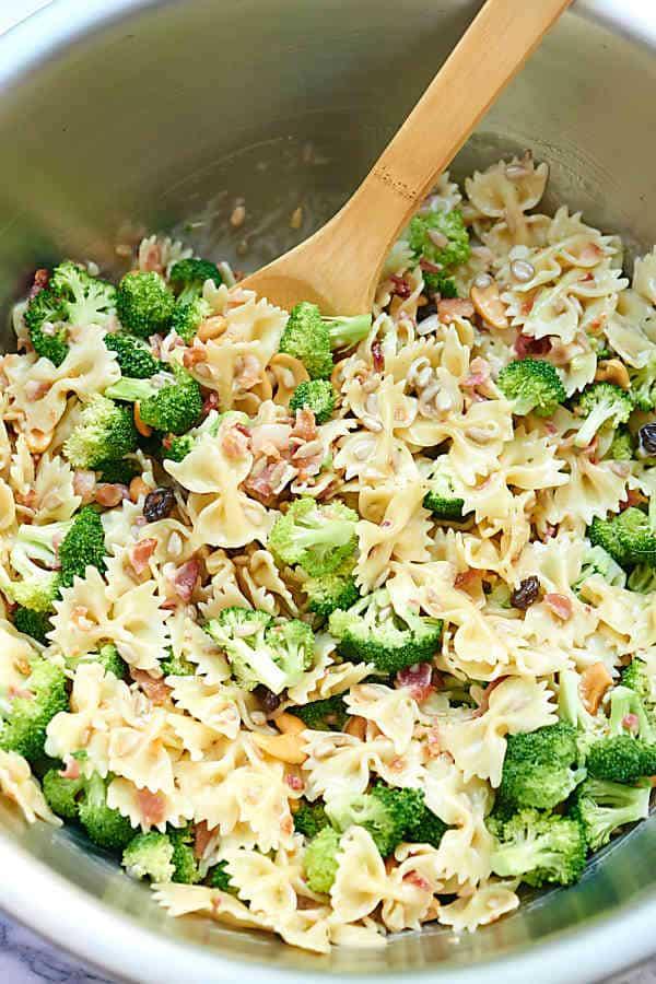 large bowl of broccoli pasta salad above